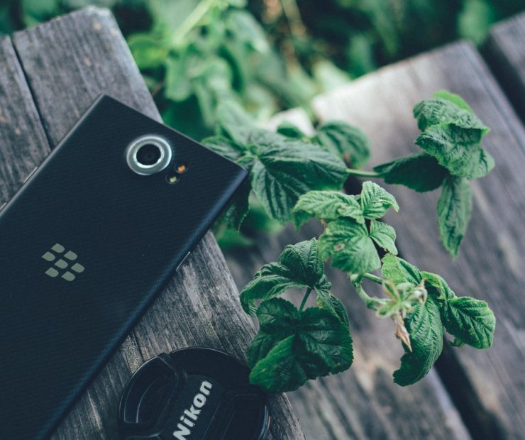 Black Blackberry Priv with Nikon Lens Cover